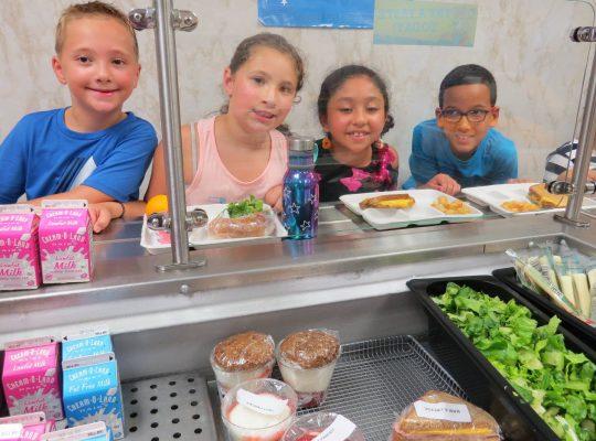 elementary school kids in food line
