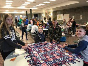 student making blankets