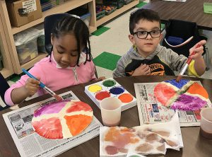 students making art with watercolors