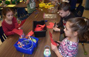 Kindergarteners doing fine motor skill activities