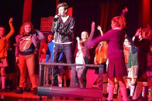 kids performing in drama club performance