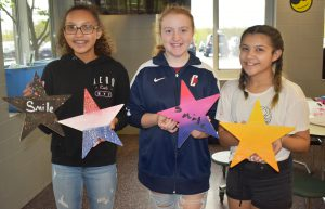 Students holding stars