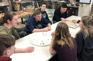 Students playing Aggravation