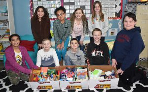students gathering with donated items