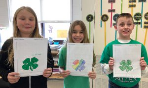 students with shamrock pictures