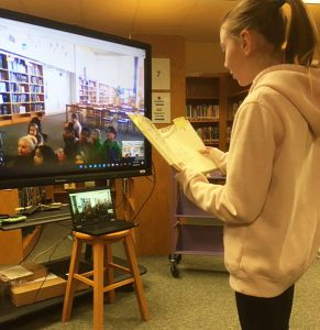 student reading to other via Google hangouts