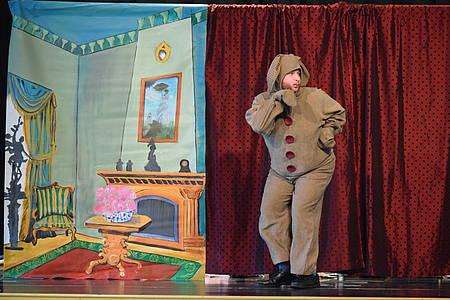Actor dressed up as Velveteen rabbit walks across stage set