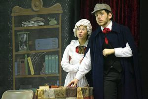 Two actors on stage playing a Sherlock Holmes mystery