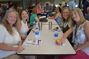 teachers sitting around cafeteria table