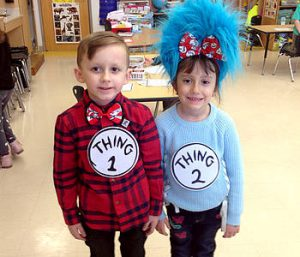 "two student dressed as Seuss's ""thing 1"" and ""thing 2"""
