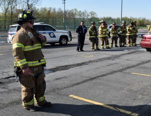 Firefighter talking to students