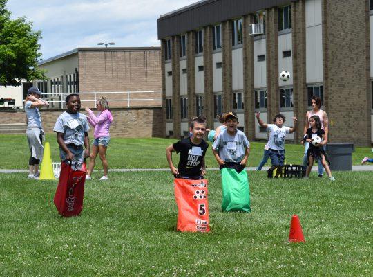 Students doing bag race
