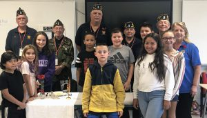 Veterans and students together by a table