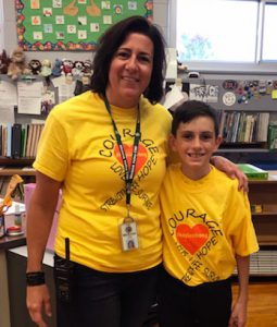teacher and student wearing gold shirts