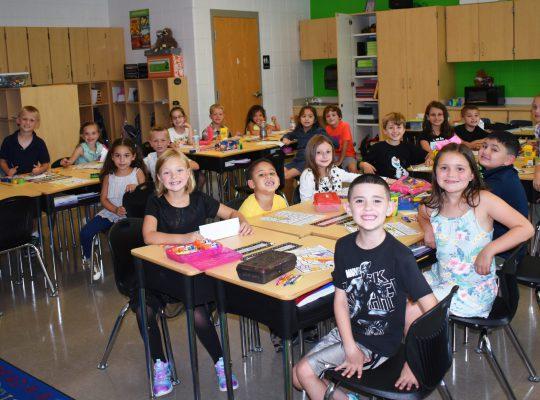 students sitting at desks