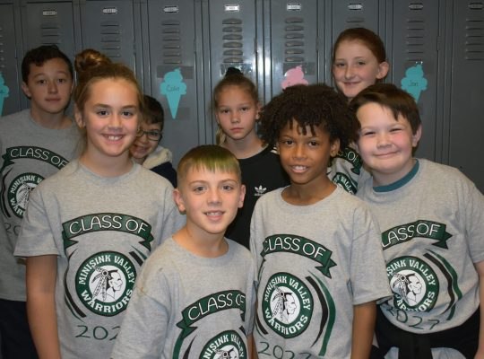 5th graders wearing their school shirts