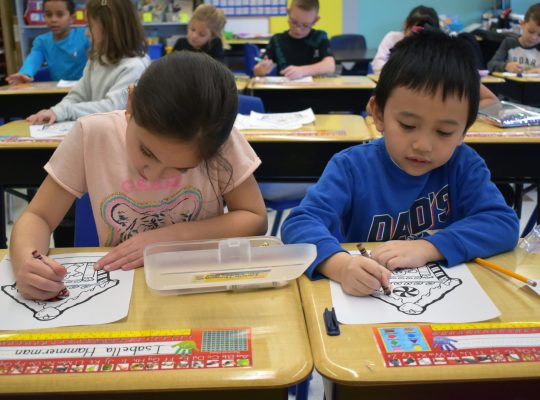 two students coloring