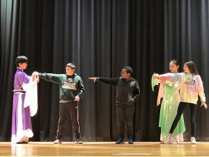 Students on stage with chinese performers