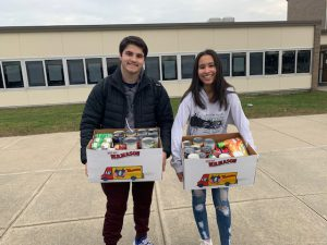 Two students with boxes of food