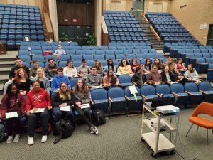 students sitting in auditorium
