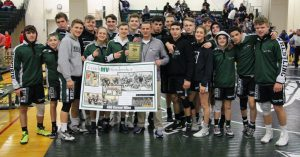 students with wrestling coach who recently earned 400th game win