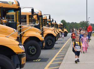 students arriving to school on buses