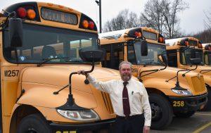 Harold Nicholson with school buses