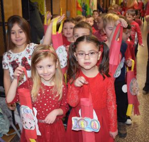 girls in parade with handmade chinese lanterns