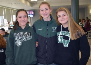 Three middle school girls wear Minisink clothing