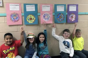 students with doughnut writing project
