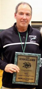 Coach with plaque