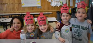 5 students wearing 100th day of school hats