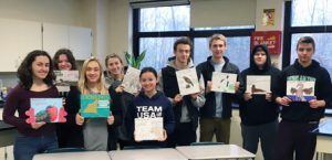 College biology class holding artwork