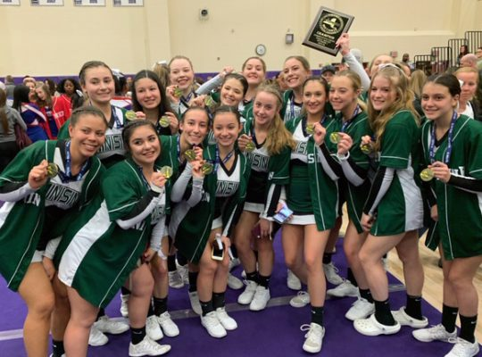 Varsity cheer team with Section IX plaque