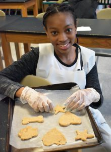 student with cut outs ready to bake