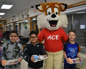 Ace the fox with students at breakfast