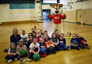 Mascot fox with kindergarten gym students