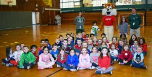 Mascot fox with kindergarten and 3rd grade students