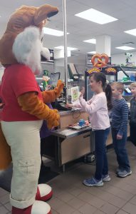 fox mascot at cafeteria line with kids