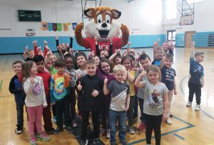 Otisville gym students with fox mascot