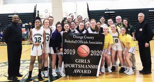 Girls baskeball team and coaches receiving award
