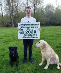 Boy with dogs and yard sign