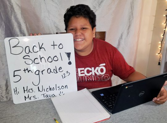 student with chromebook