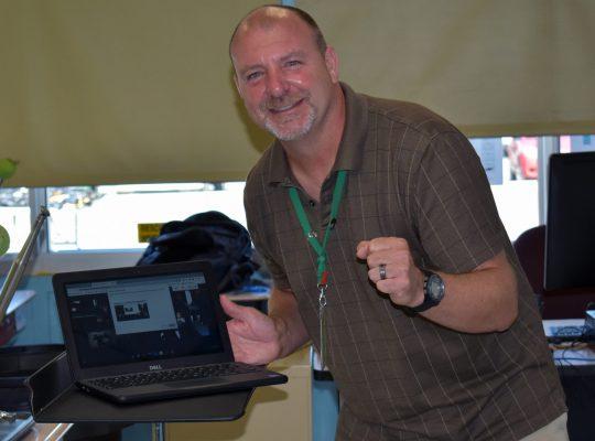 teacher with chromebook