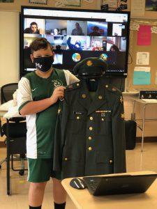 student with grandpa's uniform