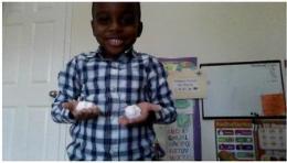 boy holding faux snow