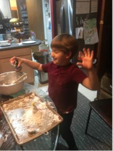 happy boy making faux snow