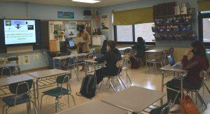 high school teacher instructing class