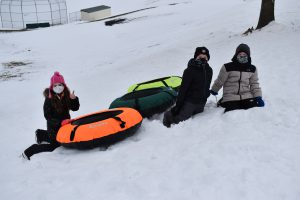 IS students with snowtubes