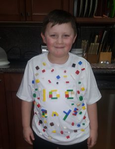 student with 100th day shirt